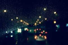 Free City View Through A Window On A Rainy Night Stock Photo - 77410220