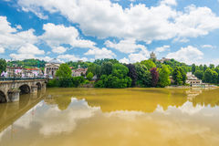 City view of Torino (Turin, Italy) by daylight in spring season. Monte dei Cappuccini Church and Gran Madre Cathedral overlooking Po River lush green trees on Royalty Free Stock Images