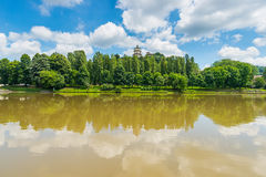 City view of Torino (Turin, Italy) by daylight in spring season. Monte dei Cappuccini Church on hilltop overlooking Po River and lush green trees on the banks Royalty Free Stock Photos