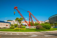 City view of Vigo with circular crossroad, buildings and the harbour crane in the center. Spain, Galicia. Royalty Free Stock Images