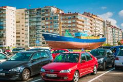 City view of Vigo with houses, cars and the ship on the ground. Royalty Free Stock Images