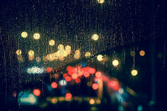 City view through a window on a rainy night Stock Photography