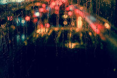 City view through a window on a rainy night Royalty Free Stock Photos