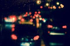 City view through a window on a rainy night Stock Photo