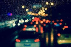 City view through a window on a rainy night Stock Images