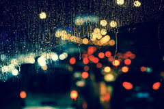 City view through a window on a rainy night Royalty Free Stock Image