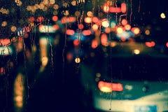 City view through a window on a rainy night Stock Photos