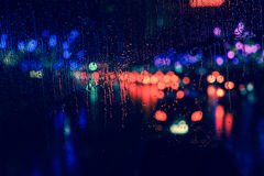 City view through a window on a rainy night Royalty Free Stock Images