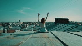 Woman sitting on the roof. stock footage