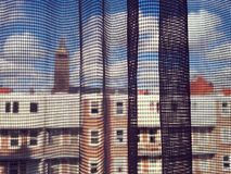 City viewed through net curtains Royalty Free Stock Photography