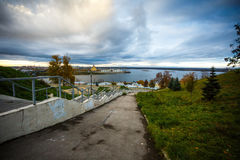 City views. Cityscape with river and clouds in the sky Stock Image