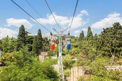 Cable car among the trees. City views of Yalta from the height of the cable car Royalty Free Stock Photography