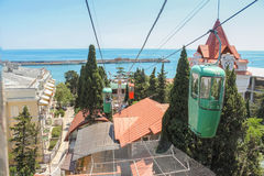 Cable car over the roofs. City views of Yalta from the height of the cable car Stock Photo