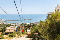 View from the cable car cabin. City views of Yalta from the height of the cable car Stock Photos