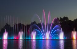 The city of Vinnytsia is a waterfront near the Roshen plant, in the evenings the fountain shows a laser show for. Residents and guests of the city Royalty Free Stock Photo
