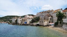 City Vis. View of gravel coast line of city Vis with ruined houses and old buildings made of stone on the beach Stock Images