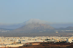 City and volcano. Arrecife, Lanzarote, Spain Stock Photography