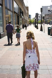 City walk. Young girl standing in sidewalk in city Royalty Free Stock Images