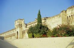 City Wall - Avignon - film grain. The ancient stone city wall of Avignon, France with a garden in front stock photos
