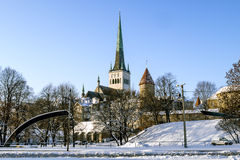 City wall and Cathedral of St. Olaf in old Tallinn. Estonia Royalty Free Stock Photography