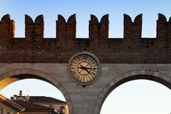 City wall with clock. Ancient city wall with clock in Verona Italy Royalty Free Stock Photography