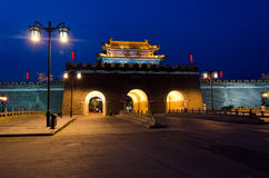 City Wall Gate at night in Qufu, China. City Wall Gate, Qufu, Shandong Pronvice, China. Is one fo the few cities in China that still has a City Wall Stock Photo