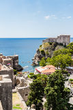 City walls and Fort Lovrijenac guarding Old Town in Dubrovnik, C. DUBROVNIK, CROATIA - JULY 19th, 2016: city walls and Fort Lovrijenac guarding Old Town`s Pile Stock Image