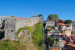 City walls with Guindal Funicular in Old Porto, Portugal stock image