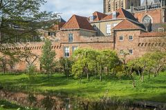 Citywall in Zutphen, Netherlands. City walls in Zutphen, Holland. In the foreground an orchard full of blooming fruit trees Stock Photo