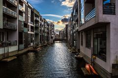 City with water channels. Beautiful architecture with water channels between the buildings. Beautiful colors and contrasts. It is early evening when the sun is royalty free stock image