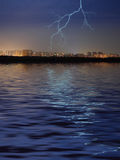 City, water and lightning Royalty Free Stock Photography