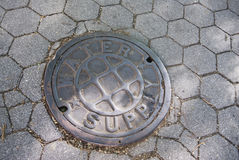 City water supply manhole cover Royalty Free Stock Photo