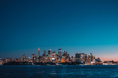 City waterfront skyline illuminated at sunset Royalty Free Stock Images
