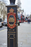 City of Westminster lightpost. LONDON, UK - DECEMBER 20: Detail of light post in front of Sommerset House depicting the City of Westminster coat of arms and red stock photos