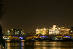 City of Westminster at Night. Skyline of the City of Westminster beyond Waterloo Bridge at Night as seen from the south bank of River Thames Royalty Free Stock Photo