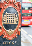 City of Westminster sign in London with red bus on background Stock Photos