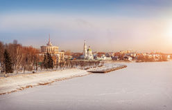 City in winter chains. Frosty sunny day over the city with views of the monastery and the river station Royalty Free Stock Photo