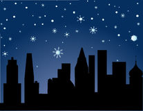 City in Winter - starry night Stock Photo