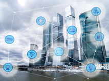 City and wireless communication network. Modern city with skyscrapers and wireless communication network, IoT Internet of Things and ICT Information Stock Images