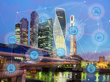 City and wireless communication network. Night city and wireless communication network, IoT Internet of Things and ICT Information Communication Technology Stock Images
