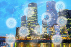 City and wireless communication network. Night modern city and wireless communication network, IoT Internet of Things and ICT Information Communication stock image