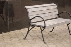 City wood bench on the street.  Royalty Free Stock Photography