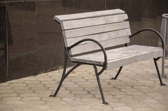 City wood bench on the street.  Royalty Free Stock Photo