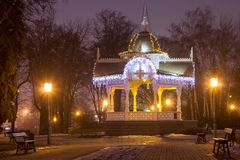 City Wooden Gazebo Decorated with Garlands. In New Year's Eve Stock Photo