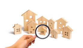 City of wooden houses on a white background. The concept of urban planning, infrastructure projects. Buying and selling real stock images