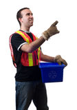 City Worker Pointing. A young city worker pointing at something, isolated against a white background Royalty Free Stock Images