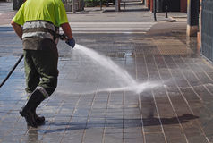 City workers - cleaning and washing of city streets Royalty Free Stock Images
