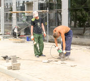 City Workers Cutting Brick Blocks Royalty Free Stock Photography