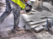 City workers - disc grinder and paving slab, Spain Royalty Free Stock Photography