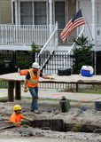 City workers labor at trenches dug on a Chicago residential. City workers labor at trenches dug on a residential street in Chicago in preparation for sewer pipe Royalty Free Stock Photography